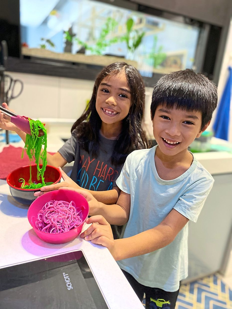 Odelia has been teaching Lea (left) and Ezra how to cook simple dishes and bake as they are so bored during the lockdown.  — ODELIA ZARSADIAS