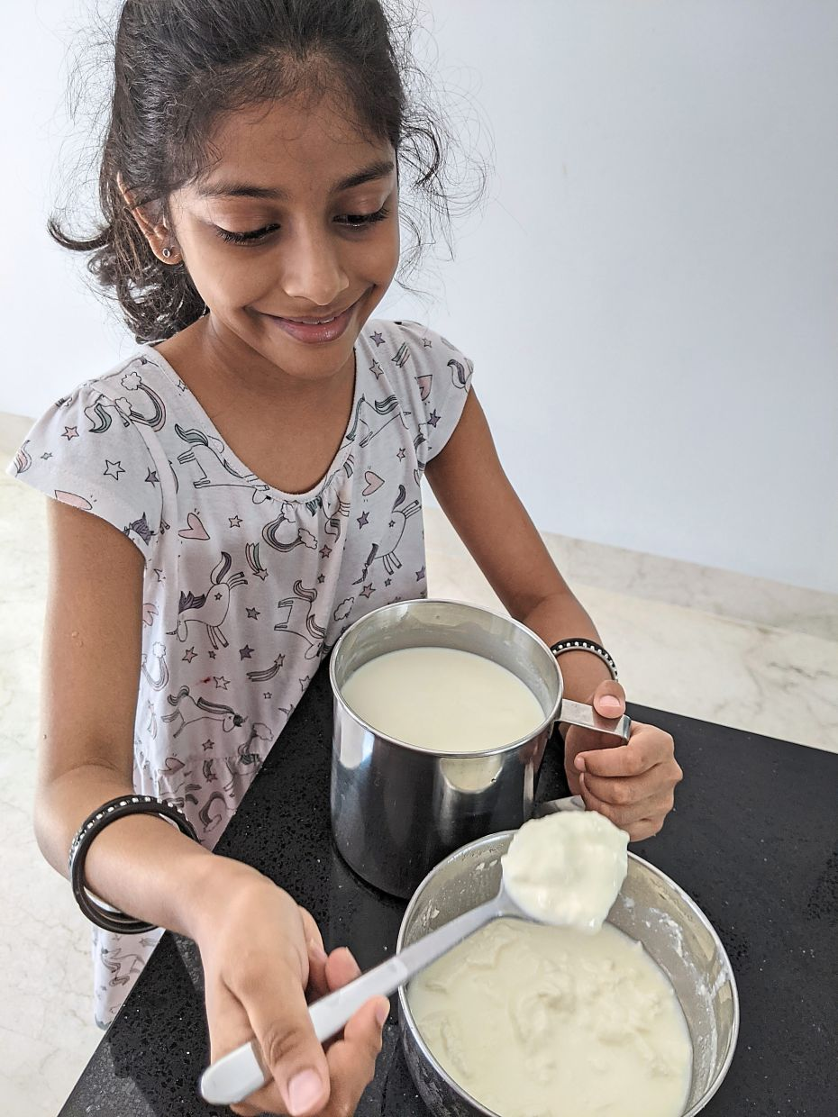 Seven-year-old Sanskrti is now responsible for making the family's homemade yoghurt and has very quickly mastered the skill. — BHUMA PARANJOTHY