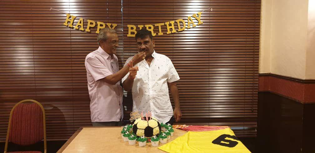 Malaysian football legend in the 60s & 70s, Datuk N. Thanabalan feeding the cake to Guna.