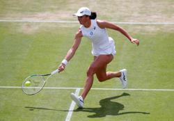 Tennis-Wimbledon day seven
