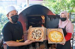 Siblings offer special pizza with Musang King topping