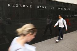 Australia's central bank tapers QE but affirms low rates outlook