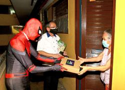 Spider-Man swings in with groceries at Hang Tuah Flats