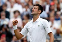 Tennis-Men's quarters has fresh look, but Djokovic and Federer loom large