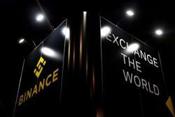 Crypto exchange Binance to double compliance staff as regulators circle
