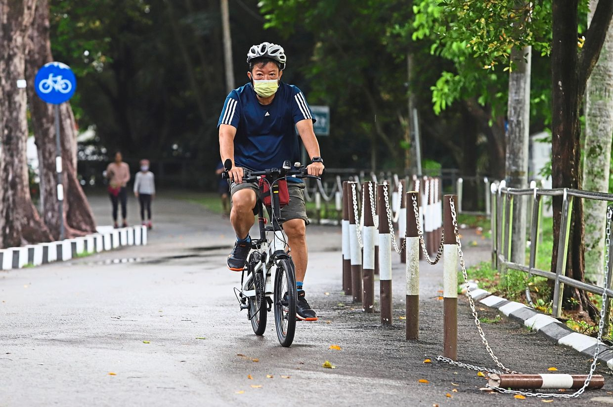 A cyclist seen riding solo at the City Park.