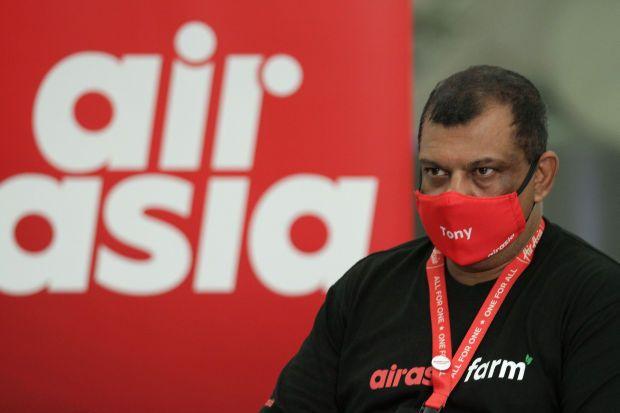 Tan Sri Tony Fernandes, CEO of airasia Group flagging off the first shipment of Harumanis mangoes to Sabah by airasia farm at the Kuala Lumpur International Airport (klia2). — YAP CHEE HONG/The Star