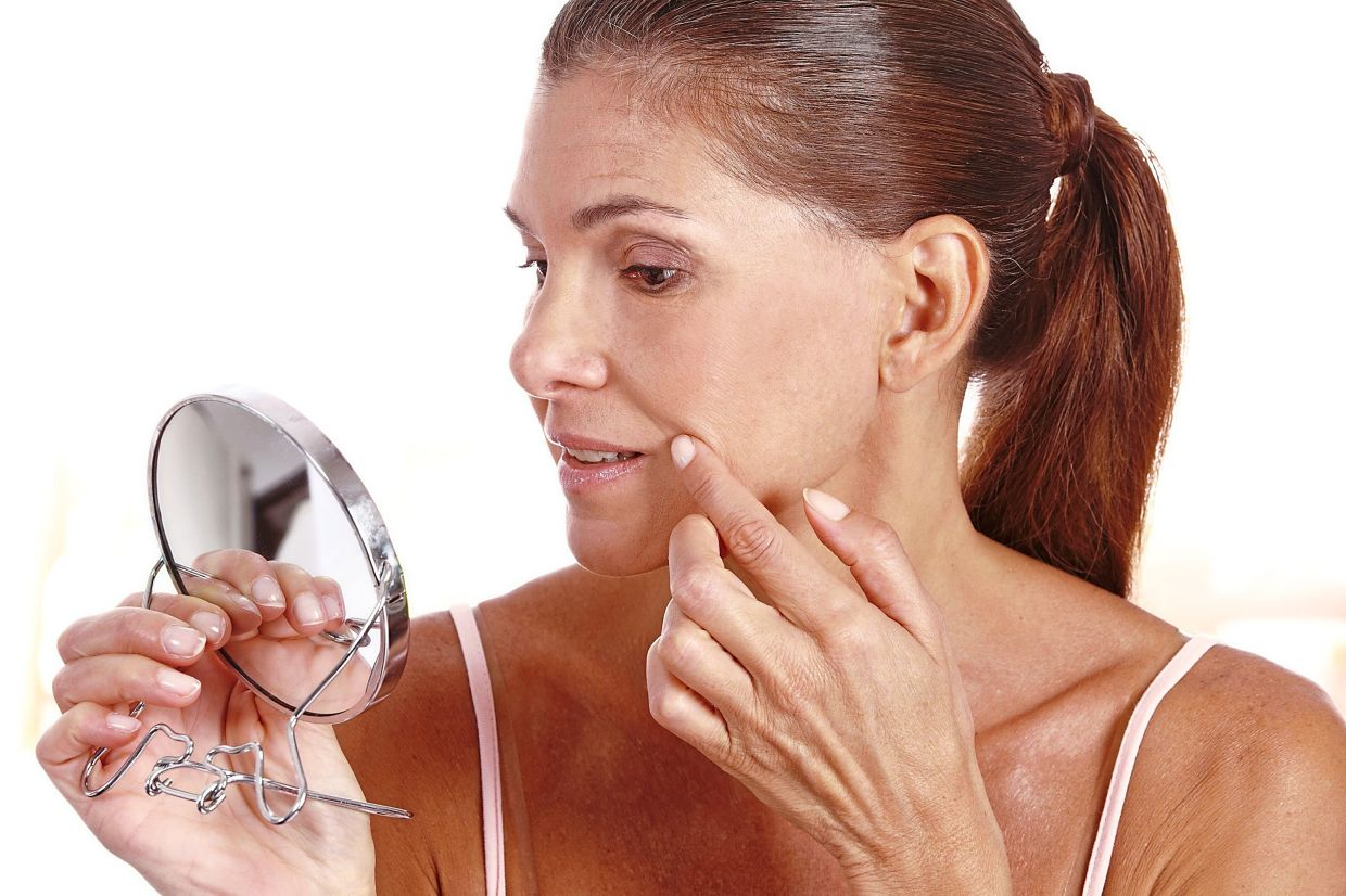 Daily sun exposure accelerates the development of fine wrinkles, freckles and age spots, so do minimise your exposure and wear sunscreen whenever you go out. — TNS