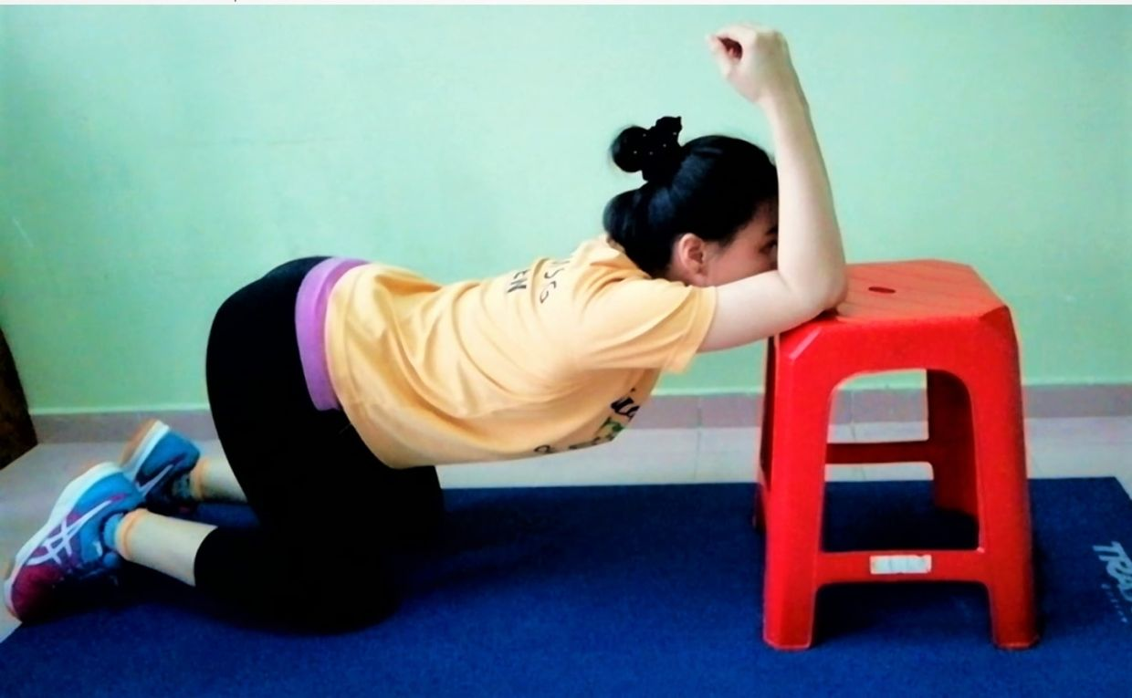You can use a stool or a low table for the thoracic spine mobility exercise.