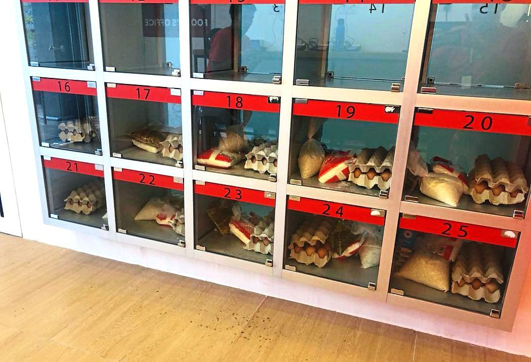 The pigeonholes where the food items are placed for collection.