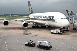 Insight - Cash-rich Singapore Airlines aims for regional dominance