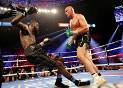 Boxing-Fury tests positive for COVID-19, fight with Wilder postponed