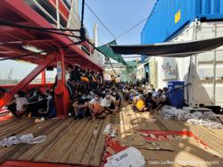 Nearly 600 rescued migrants disembark from charity boat in Italy
