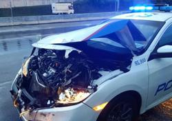 Police car badly damaged in car chase, suspect still on the loose
