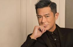 Female security staff at China airport looks happy to body search Louis Koo