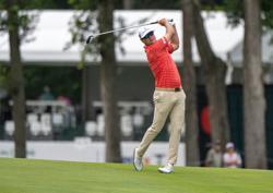 Golf-Former champion Johnson withdraws from British Open