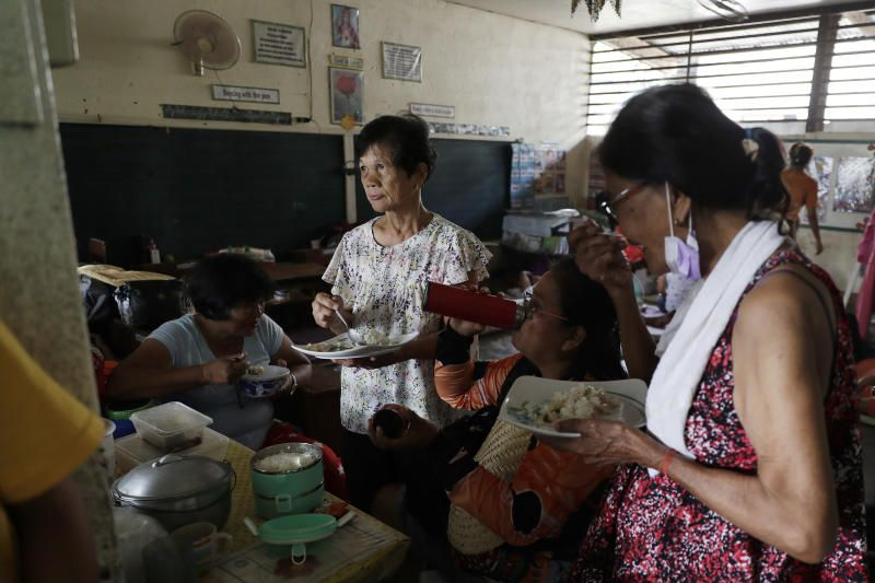 Residents who fled their homes eat in an evacuation center in the town of Laurel, Batangas province, Philippines on Friday, July 2.Thousands of people were being evacuated from villages around a rumbling Taal volcano near the Philippine capital on Tuesday (July 13, 2021) but officials said they faced another dilemma of ensuring emergency shelters will not turn into epicentresof Covid-19 infections. - AP