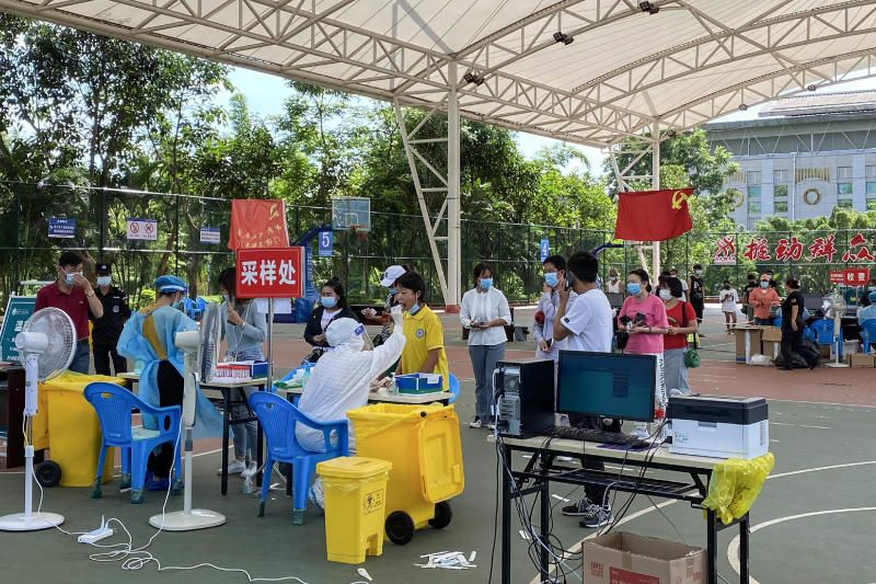 People queue to undergo nucleic acid testing for the Covid-19 coronavirus in the city of Ruili which borders Myanmar, in China's southwestern Yunnan province. - AFP