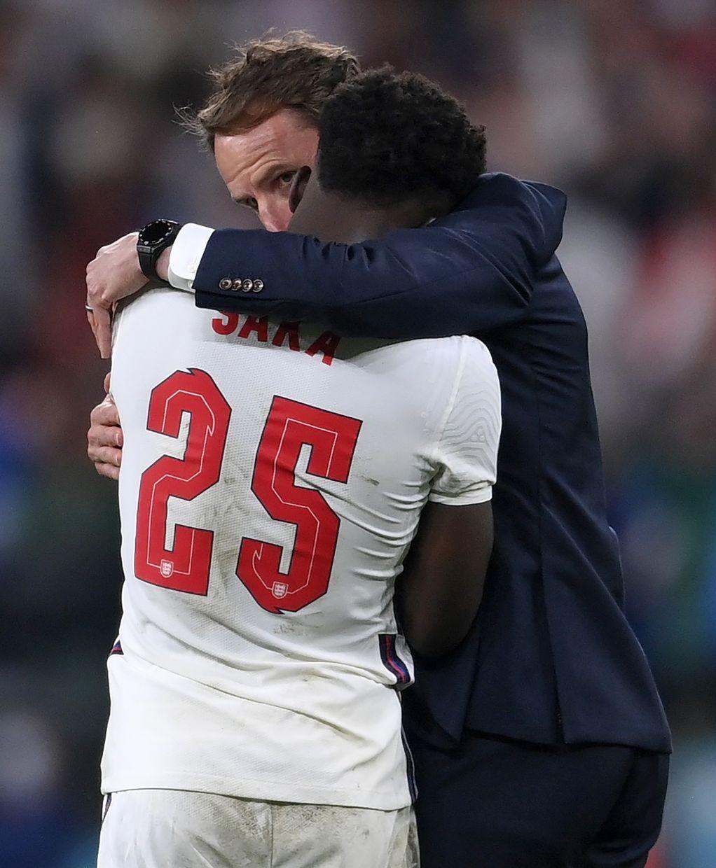 Southgate consoling Saka after the Euros final penalty shootout. — AP