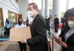 Socks, timelines questioned in Guan Eng trial