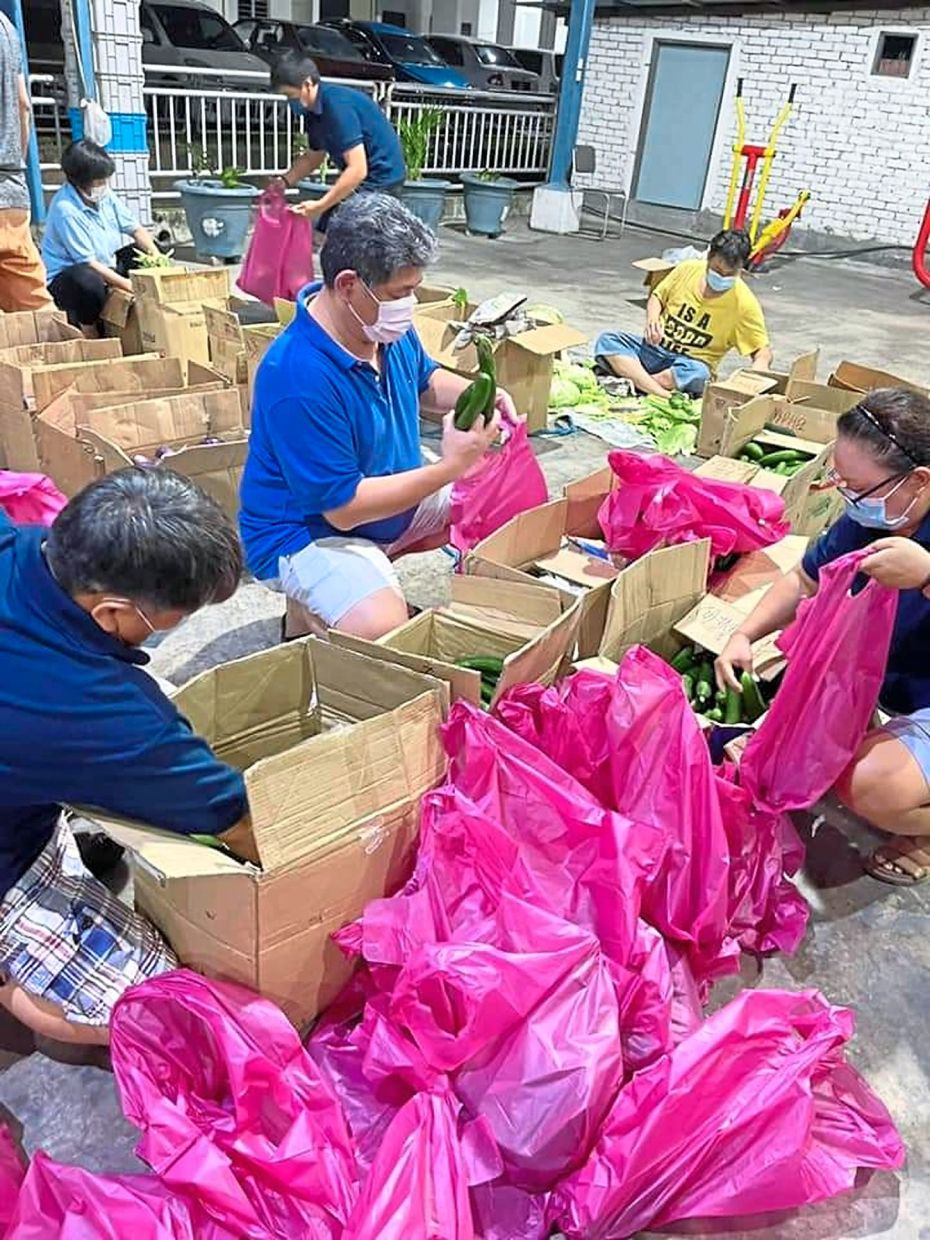 Fresh vegetables from Cameron Highlands being placed into individual packs for the needy.