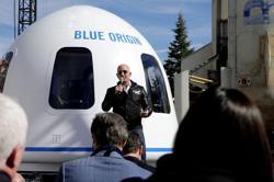 Bezos' Blue Origin to make history with unpiloted civilian space flight