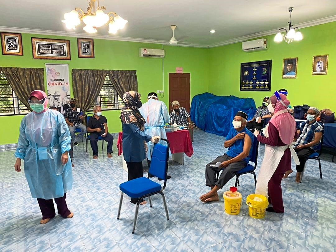 One of the smaller vaccination centres set up in a community hall in Seri Medan.