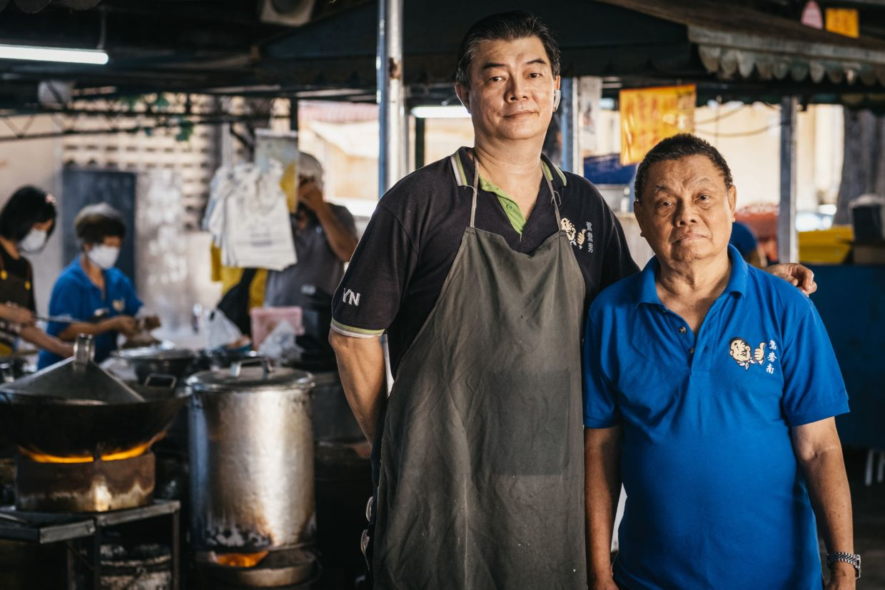 Boh Nan (left) took over the business from his father Kin Kong (right) and was initially just focused on maintaining the business in Alor Setar, but has since become very enthusiastic about delivering the family's noodles to other states. —  ANGEL LOW