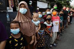 Jokowi urges 'sense of crisis' in virus hotspot Indonesia