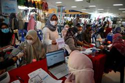 Delta variant, holiday, migrant workers major reasons for Indonesia's Covid-19 record spike, say officials