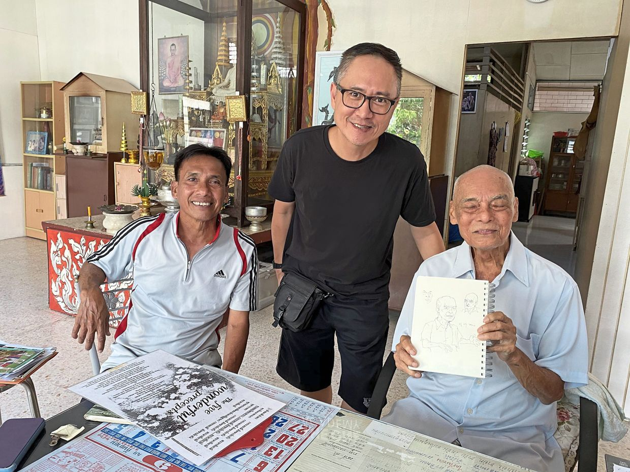 Lefty (centre) visiting Thai Menora legend Pak Wandee (right) and his son Boon Leua in Pulau Tikus for the 'I Am Home' project, an online exhibition, last year. It features multicultural narratives of home-making in Malaysia. Photo: I Am Home Project