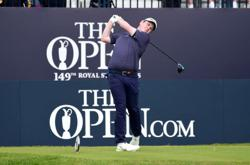 Golf-Macintyre makes hay in sun, but Royal St George's course bites back