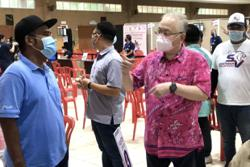 Covid-19: Yong Peng residents turn up for vaccination appointments, undeterred by downpour