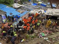 At least 18 killed in landslide, wall collapse in India monsoon rains