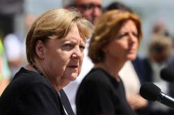 Germany's Merkel pledges fast help in 'terrifying' record floods