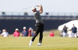 Golf-Ice-cool Morikawa wins blazing hot British Open
