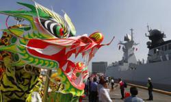 Philippine coastguard shoos Chinese ship from South China Sea zone