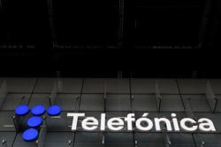 Telefonica cuts debt by 200 million euros with Colombia network stake sale
