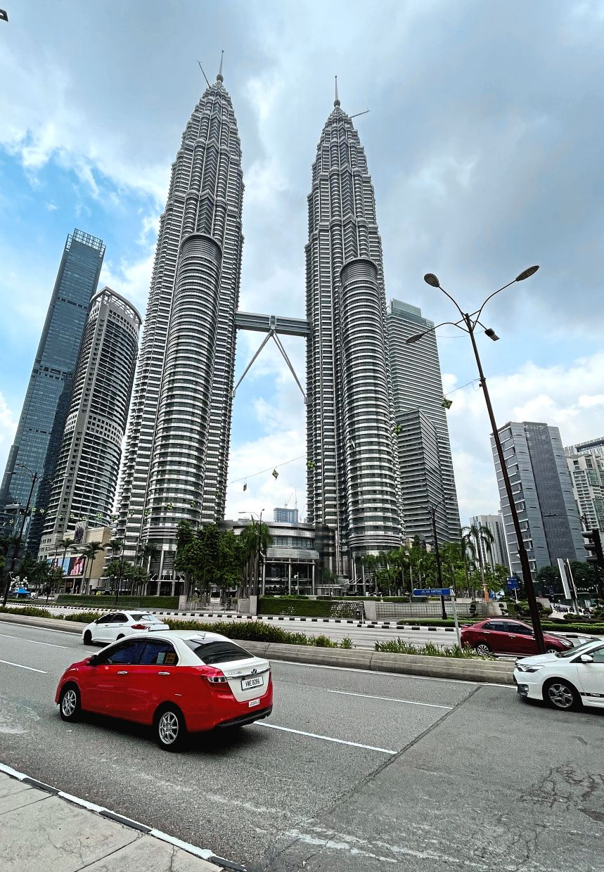 Bright outlook: The Petronas Twin Towers dot the Kuala Lumpur skyline. In a survey conducted by StanChart, Malaysia is named as one of the countries offering the best growth prospects in Asean over the next 12 months.