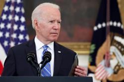 Biden softens tone on Facebook, urges action on vaccine misinformation