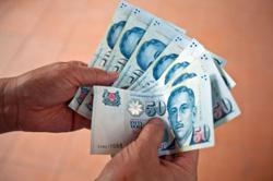 Singapore dollar to outperform regional peers