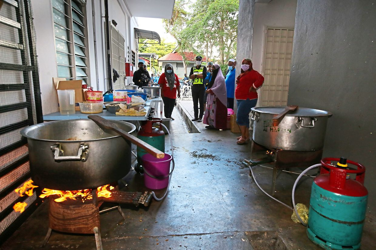 Cops conducting an inspection on Hari Raya Aidiladha sacrificial activities held at a flat in George Town.