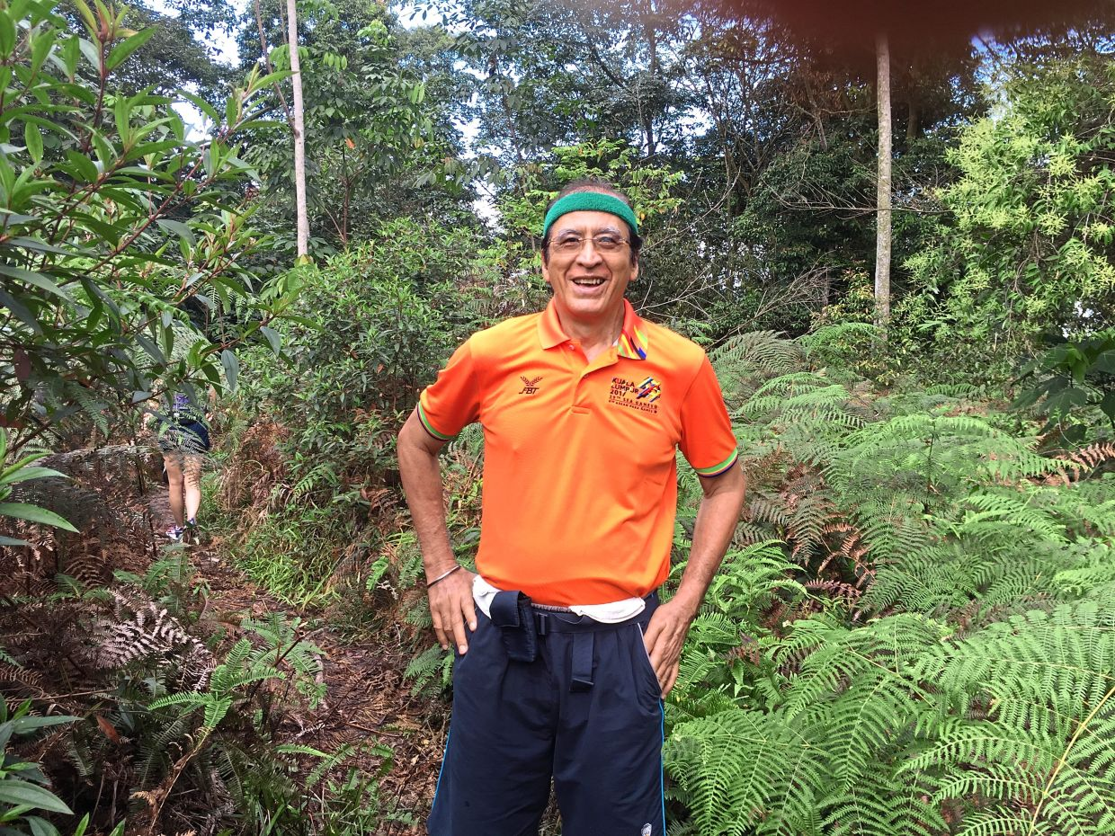 Dr Pola during a recent hike up Bukit Kiara before Covid-19 movement restrictions.