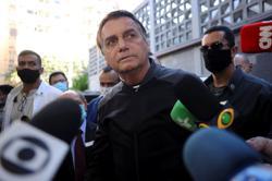 Brazil's Bolsonaro says he will veto lawmakers' $1 billion electoral fund