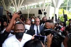 Ariel Henry formally appointed prime minister of Haiti in ceremony - Reuters Witness