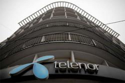 Norway's Telenor raises annual revenue outlook
