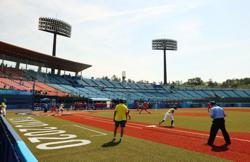 Softball-Relief for Japan, U.S. on wins as action begins at Games