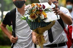 Solemn mood at Singapore school following killing of student
