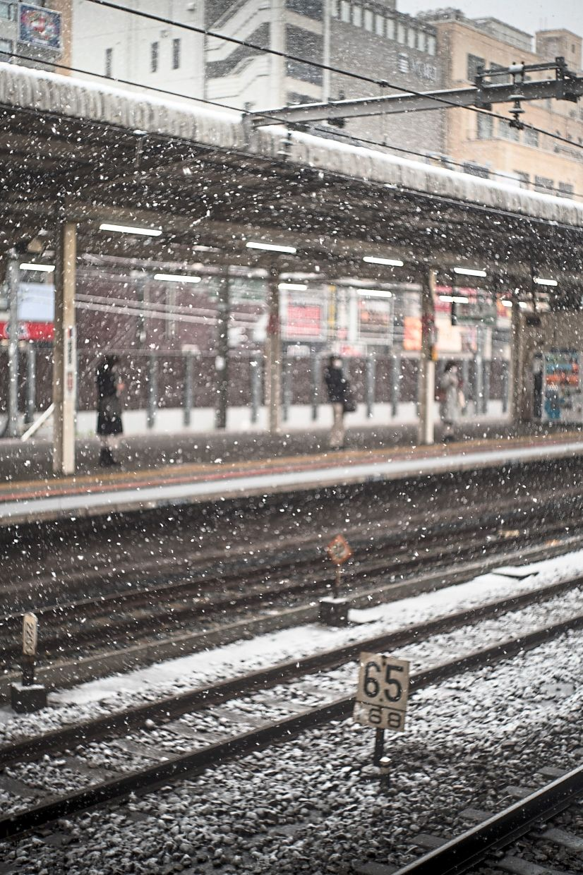 Waiting for the train on a snowy morning in Tokyo. Photo: Mahen Bala