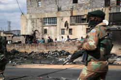 Death toll in South Africa riots rises to 276, minister says